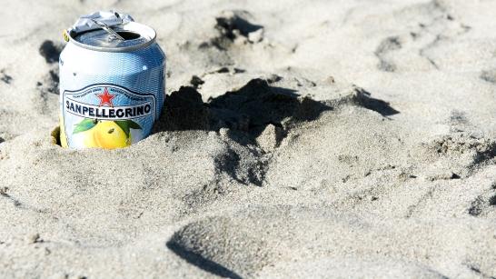 San Pellegrino soda can in the sand, California
