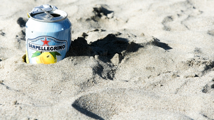 San Pellegrino soda can in the sand, California