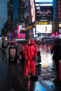 NY City worker in the rain at Times Square.