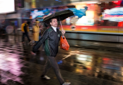 Speedwalk on rainy Times Square NYC.