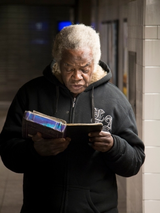 Bible reading at NYC Subway.