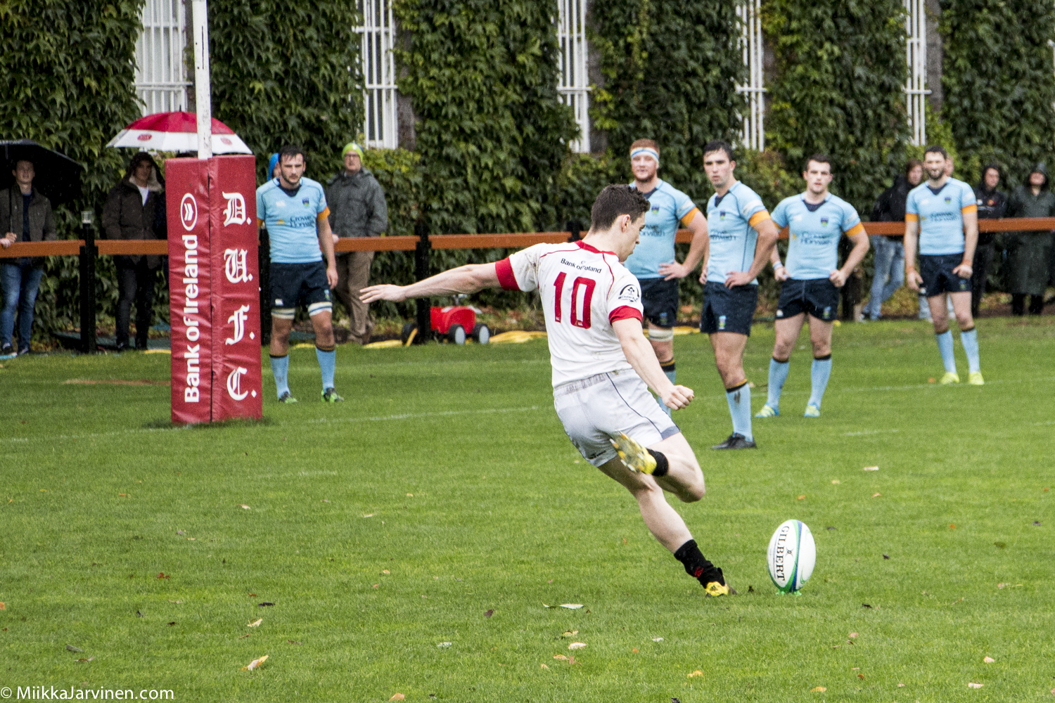 Irish rugby: UCD Rugby (blue shirt) and Trinity Rugby (white shirt) playing in rainy Dublin, Ireland 2016.